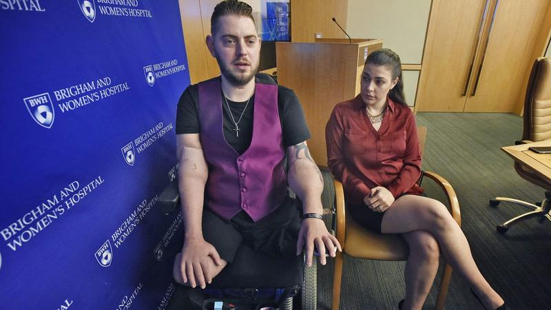 Retired Marine Sergeant John Peck speaks about his double arm transplant with his fiancée, Jessica Paker, at Brigham and Women's Hospital in Boston. (AP)